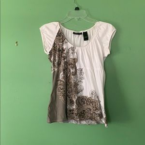White top with cute design.
